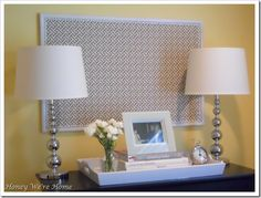 Make an old bulletin board new! Spray paint the trim, cover in a nice fabric, line the edges with thumb tacks as a decoration
