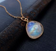 moonstone jewelry, LARGE moonstone pendant necklace, Blue flash, blue fire, gold fill, bezel set moonstone. $44.00, via Etsy.