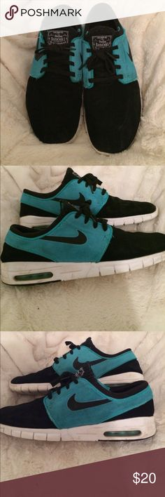 NIKE tennis shoes Black and teal Nike air SB men's tennis shoes. They have a see through window in the sole of the shoe. Well uses shoes but still look good and has lots of life Nike Shoes Athletic Shoes