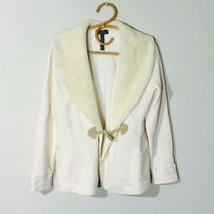 Vintage Ralph Lauren jacket Vintage P/L Ivory jacket found in moms closet. Still in great condition. Faux fur collar with a tooth and loop bottom. Real pockets in the front.                                                           body: 85% cotton, 15% polyester                        lining: 100% polyester Ralph Lauren Jackets & Coats