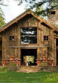This striking old timber frame rustic-modern barn is built from the reclaimed wood of older structures by RMT Architecture near the Swan Mountain Range in Montana. Pole Barn House Plans, Pole Barn Homes, Barn Plans, Pole Barn Kits, Modern Barn, Modern Rustic, Modern Farmhouse, Farmhouse Ideas, Rustic Barn