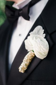 White ranunculus boutonniere with a gold stem wrap
