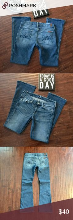 """7 For All Mankind A Pocket Bootcut Jeans 7 For All Mankind Blue Stitched """"A"""" Pocket bootcut Jeans. Thick contour waistband Medium Wash in great condition.  98% Cotton 2% spandex Size 30 Inseam 31 in Waist 32 in  Rise 8 in 7 For All Mankind Jeans Boot Cut"""