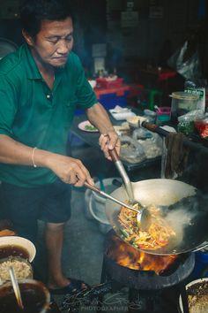 Cooking at a street stall, Bangkok, Thailand