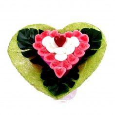 Bouquet de bonbons. Fini le bouquet traditionnel, osez le bouquet à dévorer.  Ce bouquet fera pétiller les yeux de votre « cœur ». Composé d'environ 20 bonbons.