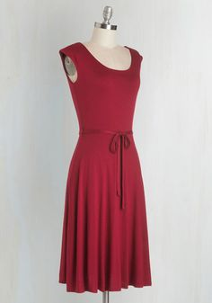 Walk a laid-back path to fashionable in this burgundy midi dress! This flexible, jersey-knit frock boasts oodles of casual flair with a classic A-line silhouette, cap sleeves, a low-key scoop neck, and a removable satiny sash - and the super-soft fabric makes this minimalist look a true pleasure to parade.