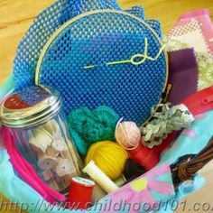 Toddler friendly sewing basket. Diggin' it for Muu (maybe with burlap instead of shelf-liner foam)