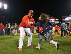 St. Louis Cardinals right fielder Carlos Beltran embraces his daughter Eivana, 5, after Game 6 of the National League Championship Series between the St. Louis Cardinals and the Los Angeles Dodgers on Friday, Oct. 18, 2013, at Busch Stadium in St. Louis. (AP Photo/St. Louis Post-Dispatch, Chris Lee)
