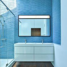 Serene  relaxing #bathroom #design featuring #blue #linear #tiles and an abundance of natural #light! Via @archinecthq  showcasing the Fenlon House in #losangeles #california by Martin Fenlon Architecture; Photo: Zach Lipp.  #architecture #arquitectura #baño #decor #glasstile #home #homeinspo #homedecor #interiors #inspiration #interiordesign #idcdesigners #moderndesign #stylish #tile #tileporn #tilework #tilesetter #tileometry #tileaddiction #wall #walltiles by tileometry