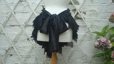 """one idea for ostrich - scraps of black tulle plus African-pattern scraps in an """"apron"""" bustle longer in back than in front. Lose the bow, add  white feather boa belt"""
