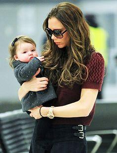 OMG that little wool COAT! Cutie! Victoria Beckham  The designer carried daughter Harper Seven Beckham through the airport.