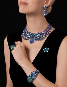 "CARTIER. ""Sambhal"" Set - platinum, engraved sapphires from Burma, sapphire and ruby beads, carved emeralds and sapphires, cabochon-cut rubies, brilliant-cut diamonds. #Cartier #RésonancesDeCartier #2017 #HauteJoaillerie #HighJewellery #FineJewelry #TuttiFrutti #CarvedStones #Emerald #Sapphire #Ruby #Diamond"
