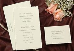 A traditional pearl bordered ecru wedding invitation card with torn edge. Wedding Invitations by Wedding Invitations-WeddingBeDazzle