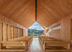 Small chapel by Estudio Cella stands alone in the heart of an Argentinian forest.