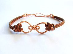 I have created this beautiful infinity link using 16 gauge copper wire. It includes 2mm natural brown leather cord with antique copper