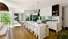 large-spaces-poolside-living-contemporary-seaside-home-6-kitchen.jpg