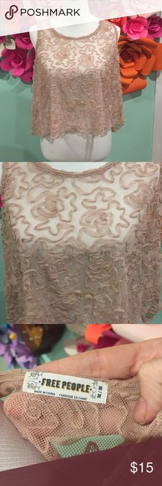 Free People Sheer Rosette Tank Almost a crop top but flowy this sheer tank looks good over any color would also look good with a FP bralette. 100% nylon hand wash cold. Free People Tops Crop Tops