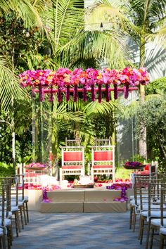 Clear mandap with pink floral bouquet accents Vibiana | A Good Affair Wedding & Event Production | Tosti Studios Photography