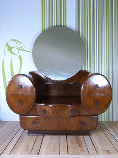 I adore Art deco dressing tables and bedroom furniture. The wood grain and round… I adore Art deco dressing tables and bedroom furniture. The wood grain and round mirrors.