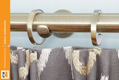 AriA™ Metal Hardware bypass brackets and c-rings allow for uninterrupted traversing of window treatment panels. Featured in Antique Brass finish. #ariametalhardware #draperyhardware #bypassbrackets #crings #rowleycompany