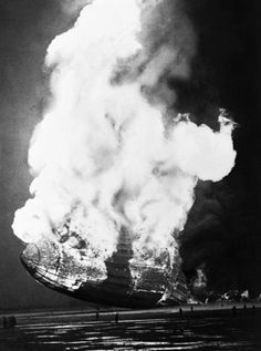 The Hindenburg hits ground after exploding mid-air. Lakehurst, New Jersey, 1937. Murray Becker