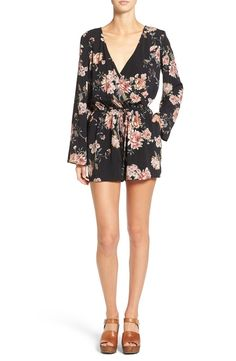 So cute! A plunging surplice neck adds a low-key glam vibe to this flowery romper with long, slightly belled sleeves and a nipped-in waistline.