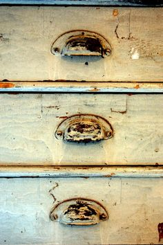 Peelin' paint & rusty pulls...IS the beauty of these drawers!