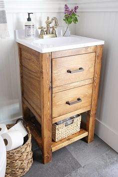 How to build a DIY bathroom vanity for $65! This DIY rustic bathroom vanity works great in small bathrooms, adds extra storage, is budget friendly, and looks cute too! Click to get the build plans and tutorial!