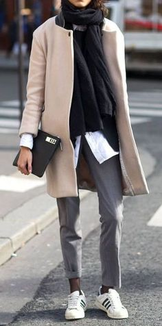 Sneakers are still strong; here, a classic camel coat with gray pants and Adidas sneakers.