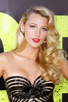 '20s Glamour Blake Lively looks every bit like a 1920s silver screen siren with her old Hollywood fingerwaves and classic red lip. We love this look because it withstands the test of time—it was popular then and it's popular now.