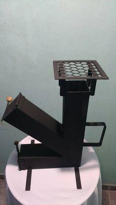 Rocket Stove Design, Diy Rocket Stove, Rocket Heater, Rocket Stoves, Outdoor Cooking Stove, Outdoor Stove, Ottoman Furniture, Metal Furniture, Jet Stove