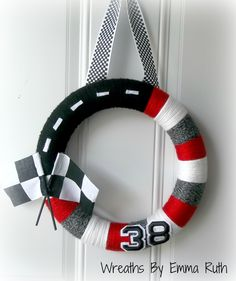 Race car theme wreath I woulk not do # but. Race Car Party, Race Car Birthday, Cars Birthday Parties, 3rd Birthday, Sports Cars For Sale, Used Sports Cars, Race Car Themes, Race Cars, Wreaths
