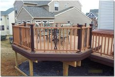 """Deck Franchising.- Elevated Octagon Eating Area Elevated Octagon Eating Area - Trex starburst pattern in Saddle color. Trex 'designer"""" rails with custom centerpieces. Two color rails and saddle and woodland brown. Gallery"""