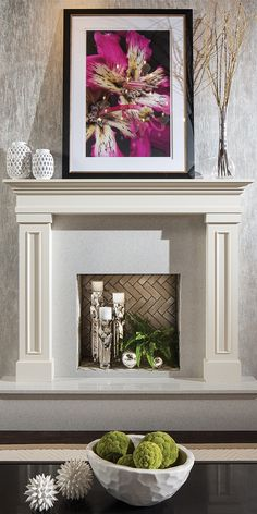 This Dura Supreme Fireplace Mantle uses large and bold art to decorate the mantle. - Dura Supreme Mantles  Cabinetry (Designed by Mingle)
