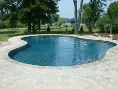 #simple is sometimes better! A basic pool shape will create a sense of unity in your backyard.