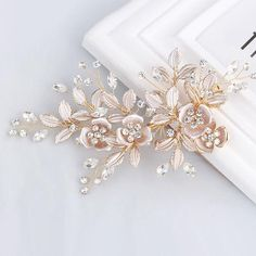 A stunning and delicate light rose gold hair clip with glistening Austrian crystals. This would make a gorgeous wedding hair accessory above a veil, in a tousled bun or on the side. This beautiful handmade item is sure to turn heads!