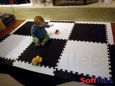 A cute play mat for a small playroom floor. This floor uses 6 SoftTiles 2x2 Interlocking Foam Mats and covers a 4 1/2 foot by 6 1/2 foot area.