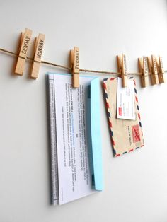 Also would be cute to write countries on the clothes pins and pin postcards to them.