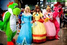 Over the last several years, Mario games have expanded to include more female characters... all princesses of course. Fans at a comic convention dress up as Princess Rosalina, Princess Daisy, and Princess Peach.
