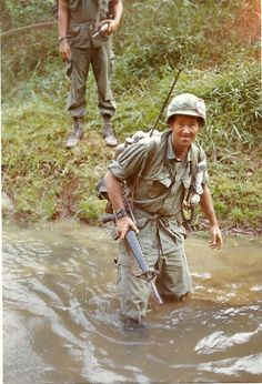 Joel Watkins, author of Vietnam: No Regrets, crossing a river during his time as an RTO with the 27th Infantry Regiment, 1969.