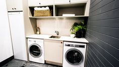 Daz and Dea's laundry on The Glasshouse included their signature paneling and an impressive drying cabinet.