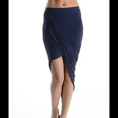 Asymmetrical Draped Skirt Navy Stretchy fabric that is higher on one side and drapes across. 95% rayon 5% spandex. Skirts