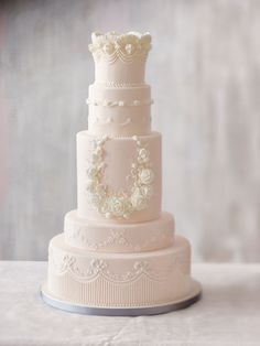 Blush Pink Wedding Cake with expert traditional piping and floral wreath is quite stunning! Cake by Bobbette & Belle.   Wedding Cakes To Suit Every Theme   Weddingbells