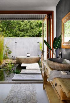Tropical resort style outdoor bathroom with freestanding bath outside in pond. Stepping stones. #tropical #resortstyle #sanctuary #resortbathroom Outdoor Baths, Outdoor Bathrooms, Modern Bathrooms, Small Laundry Rooms, Laundry In Bathroom, Log Coffee Table, Log Stools, Terracotta Floor, Level Homes