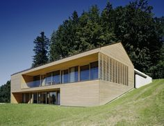Designed in wood and glass, House A, Dornbirn (AT) is a completed project by Dietrich Untertrifaller Architekten. Located on a mountain meadow above Dornbirn, Austria, this timelessly beautiful house Wooden House Design, Hillside House, Architect Design, Residential Architecture, Beautiful Homes, Building A House, Modern Design, House Styles, Houses