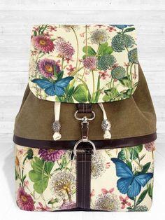 Prachtige bloem en vlindertas. Op etsy.com