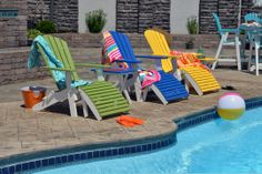 Our new folding adirondack chairs in tropical on white two-tones set the stage for a fun pool party. These will be available for 2015 at your local Berlin Gardens dealer. #adirondackchairs #poolchairs #outdoorfurniture