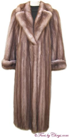 Ankle Length Stone Marten Fur Coat  #SM605; $10,500.00; Excellent Condition; Size range: 10 - 16. This is an exquisite genuine natural stone marten coat. It has a Yudofsky Furriers label and features a large notched collar and turn-back cuffs. There are two exterior velvet-lined pockets and hook and eye closures. The lining is solid cocoa brown and there is a name monogram embroidered in the lining. Your purchase will be accompanied by a copy of an appraisal. Pure elegance!
