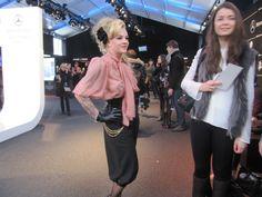 Nach dem Modestudium in Wien und einer Assistenz im Londoner Studio von Vivienne Westwood begann 2006 die Karriere der gebürtigen Grazerin mit 24 Jahren mit der Gründung ihres gleichnamigen Labels LENA HOSCHEK. Mittlerweile ist ihre Linie berühmt für ihren sehr weiblichen Retro Stil. Zu den Fans von Hoscheks Kleidern zählen auch das Potsdamer Model Franziska Knuppe, die Potsdamer Moderatorin Enie van de Meiklokjes und anscheinend auch Bruce Darnell...