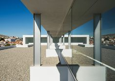 Daroca Arquitectos pairs stone with white walls at Baza employment centre